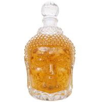 China Unique 750ml Buddha Head shape glass wine bottle for vodka and whisky empty wine bottle With Stopper on sale