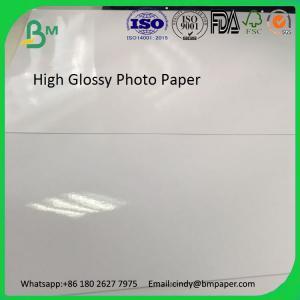 China Waterproof Cheap Cast Coated A4 Glossy Inkjet Photo Paper on sale