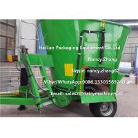 China Moving Dairy Cow Farms Vertical TMR Mixers With Heavy Duty Wheel on sale